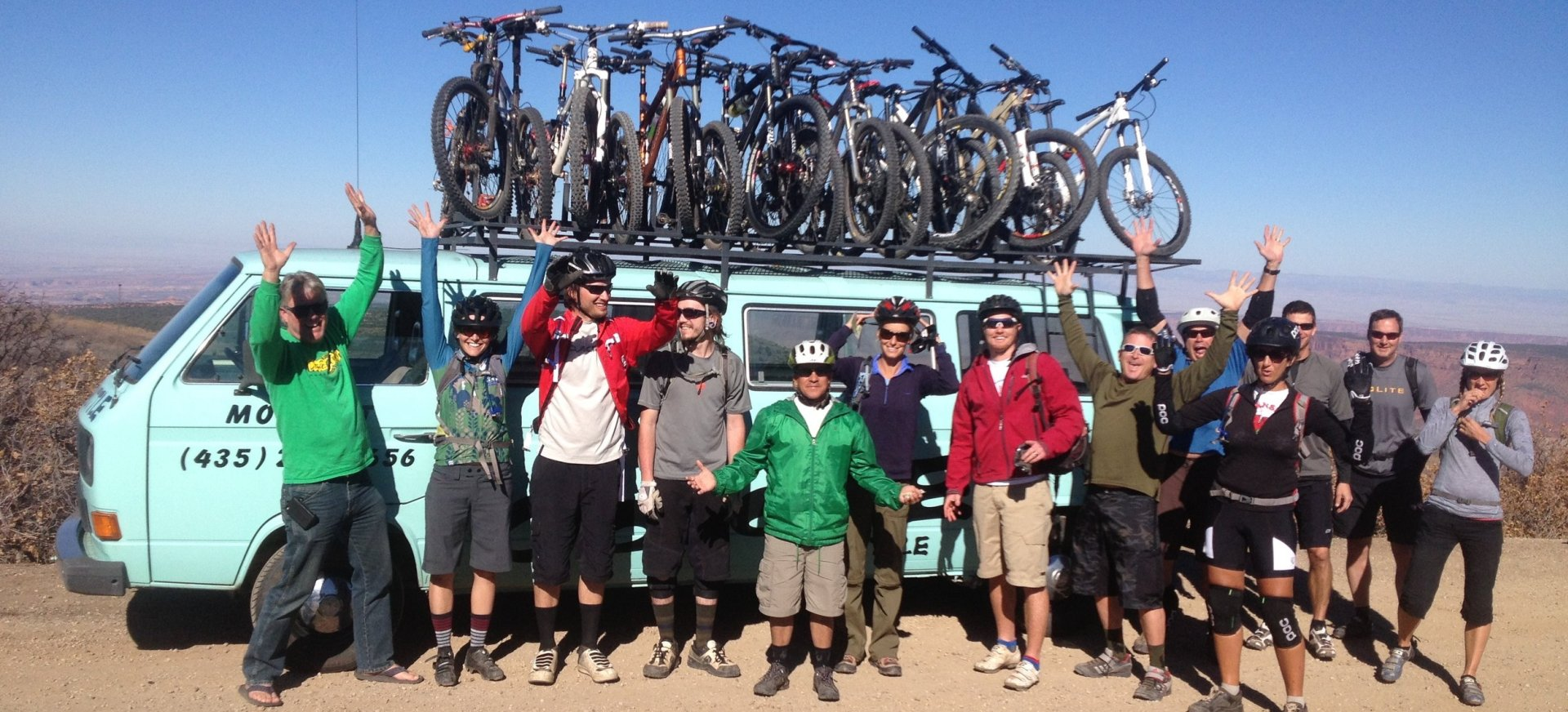 Bikers with green van in Moab